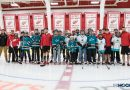 VIDEO/PHOTOS: Red Wings, Warrior surprise special hockey team with free gear, team visit