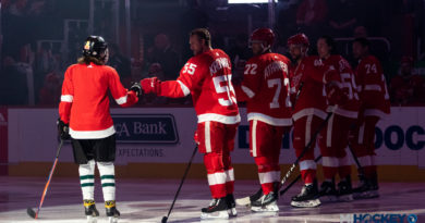 Niklas Kronwall greets a 'Youth Skater of the Game' before a Detroit Red Wings game.